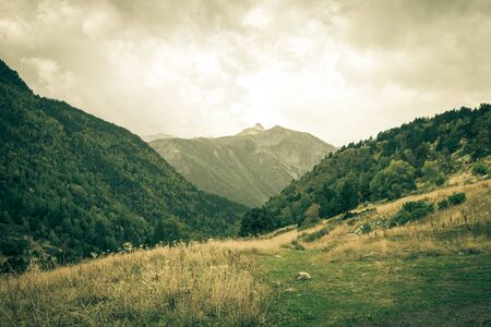 tourism in andorra: Beautiful mountain landscape in Andorra. Mountain and clouds. Toned.