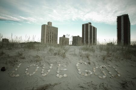 intel: inscription Love God of seashells in the sand on the coast. East rockaway Intel. New-York. US East Coast. Tinted