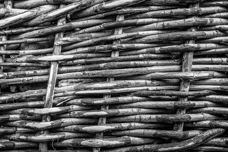 wicker bar: Wicker basket texture wall. Selective focus. background. monochrome