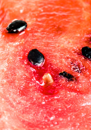black seeds: Sweet juicy watermelon with black seeds. background. Shallow depth of field