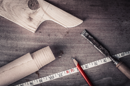 joinery: Joinery tools on an old wooden table. Toned.