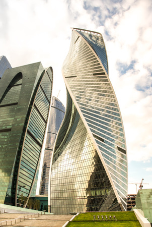 Buildings of business complex Moscow City. A lot of glass and concrete in modern architecture. Toned.