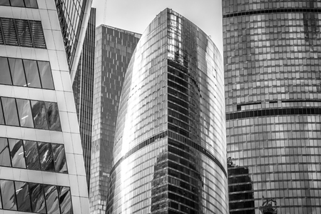 erection: Buildings of business complex Moscow City. A lot of glass and concrete in modern architecture. Toned.