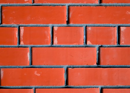 revetment: Texture of red brick wall background, modern architecture. Toned. Stock Photo