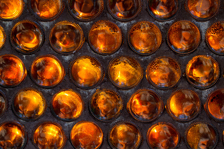 bottoms: The wall of glass bottles bottoms folded forward. Background. Selective focus. Stock Photo