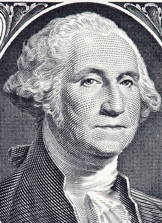 dollaro: Primo piano di George Washington ritratto su una banconota da un dollaro.