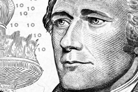 founding fathers: Close up to Alexander Hamilton portrait on ten dollar bill. Toned. Stock Photo