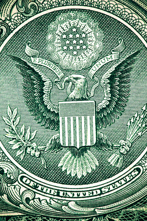 pluribus: Close up macro detail of dollar money banknotes. Toned.