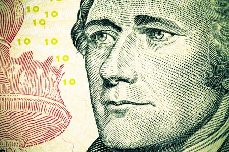 Close up to Alexander Hamilton portrait on ten dollar bill. Toned. Stock Photo