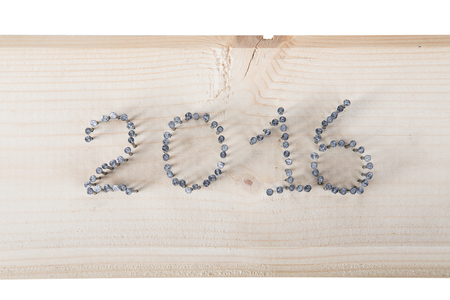 hobnail: The number 2016 of nails on a light wooden background.