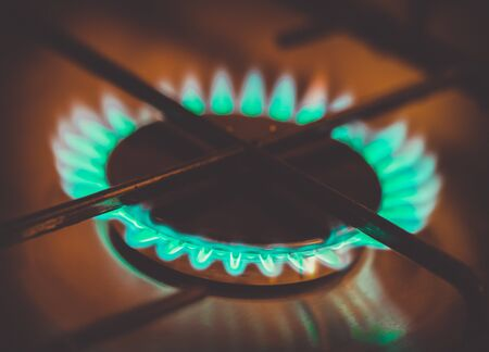 stovetop: Flame on a gas-burner. Shallow depth of field. Toned. Stock Photo