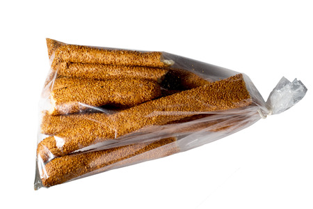 plato del buen comer: Bread sticks with sesame isolated on white background.