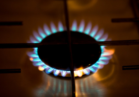 stovetop: Flame on a gas-burner. Shallow depth of field.
