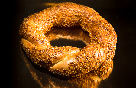 turkish bread: Turkish bread with sesame seeds on a table with reflective surface. Selective focus. Shallow depth of field. Selective Focus. Stock Photo