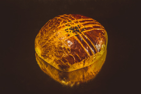 turkish bread: Turkish bread with sesame seeds on a table with reflective surface. Selective focus. Shallow depth of field. Selective Focus. Toned. Stock Photo