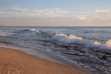 waves  pebble: Waves on pebble beach of Mediterranean sea. Turkey in autumn. Alanya. Natural background. Stock Photo