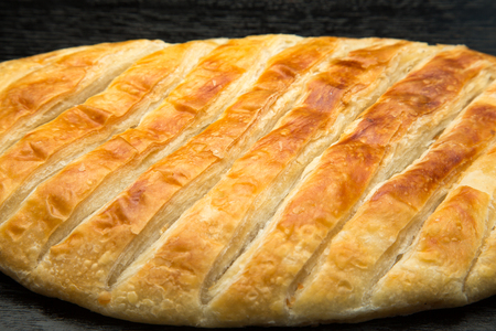 turkish bread: Turkish bread Katmer on a black wooden table or board. Selective focus. Shallow depth of field. Selective Focus.