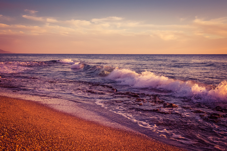waves  pebble: Waves on pebble beach of Mediterranean sea. Stock Photo