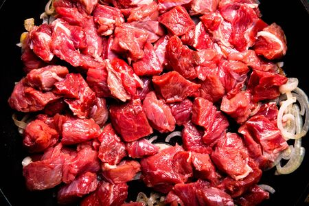 kuru: Fresh raw meat on a pan. Ingredients for traditional turkish meal - Kuru fasulye. Toned.
