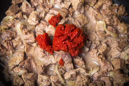 kuru: Stew meat on a pan. Ingredients for traditional turkish meal - Kuru fasulye. Toned.