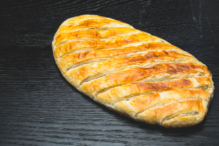 turkish bread: Turkish bread Katmer on a black wooden table or board. Selective focus.
