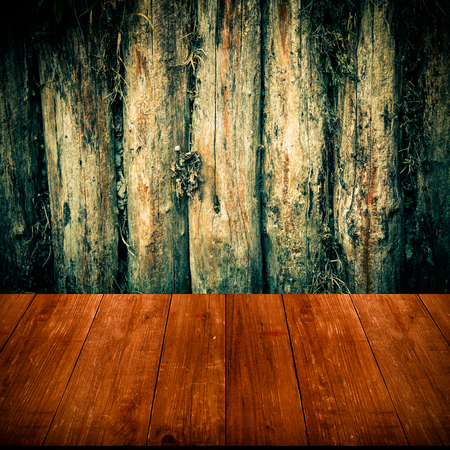 gangway: The wall of the old logs. Background. View from dark wooden gangway or bridge. Collage. Toned.