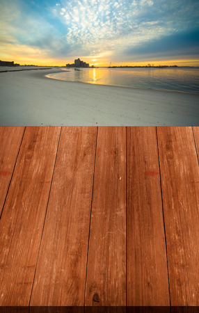 intel: View on warm sunrise on the coast from dark wooden gangway or bridge. Collage. Overlooking the Atlantic Beach Bridge. East rockaway Intel. New-York. US East Coast.