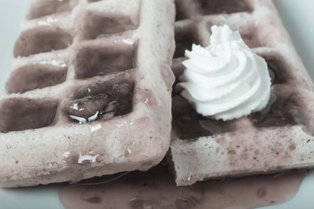strew: Traditional belgium soft fresh waffles with a decor on a plate. Toned. Stock Photo