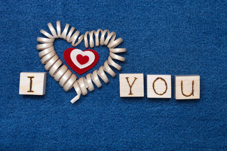 i love you sign: Wooden composition and space for text. Romantic love theme on jeans background. Stock Photo