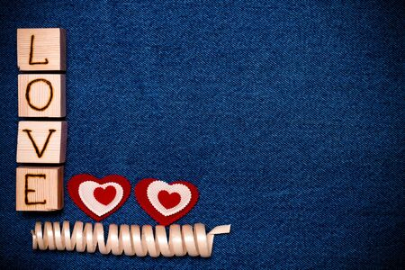 i love you sign: Textile heart, inscription LOVE on wooden cubes and space for text. Romantic love theme on jeans background. Toned.