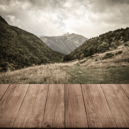 gangway: Beautiful mountain landscape in Andorra. Mountain and clouds. View from dark wooden gangway or bridge. Collage. Toned.