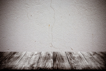 parget: Light plastered wall with crack. Background. View from dark wooden gangway, table or bridge. Collage. Toned.