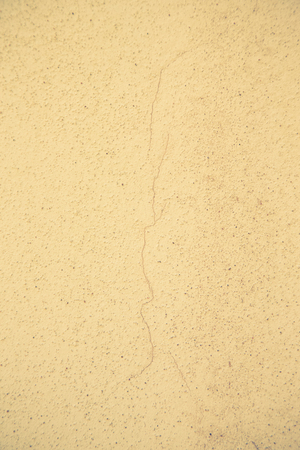 crack up: Light plastered wall with crack for background. Close up detale. Stock Photo