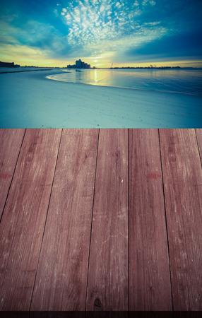 intel: View on warm sunrise on the coast from dark wooden gangway or bridge. Collage. Overlooking the Atlantic Beach Bridge. East rockaway Intel. New-York. US East Coast. Toned. Stock Photo