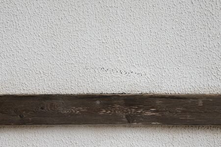 parget: Light plastered wall with wooden stripes for background. Close up detale.