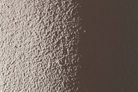 parget: Light plastered wall for background. Light from left side. Close up detale. Toned.