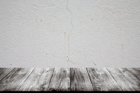 parget: Light plastered wall with crack. Background. View from dark wooden gangway, table or bridge. Collage.