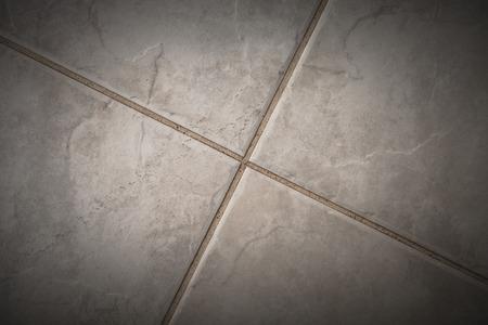 cross recess: Fragment of ceramic tiles floor. Stock Photo