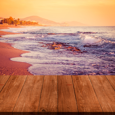 waves  pebble: View on waves on pebble beach of Mediterranean sea from dark wooden gangway, table or bridge. Turkey in autumn. Alanya. Natural background.