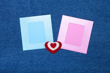 Two photoframes and space for text. Romantic love theme on jeans background.