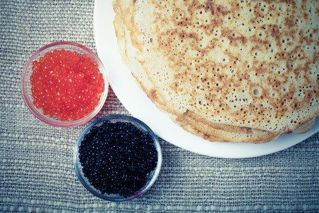 blini: Russian pancakes - blini with red and black caviar. Toned. Stock Photo