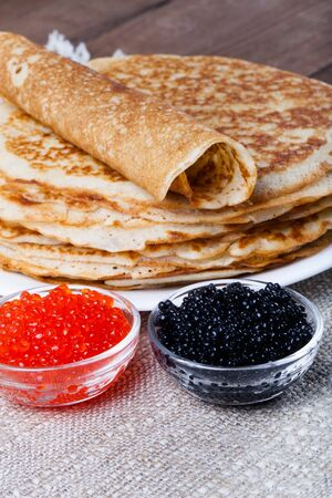blini: Russian pancakes - blini with red and black caviar. Selective focus.
