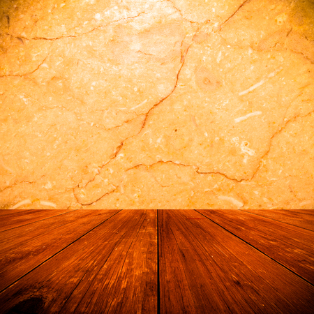 table surface: The surface of natural stone as a natural background behind old dark wooden table or board. Collage. Space for text. Toned.