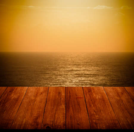 polis: Beautiful view of the Mediterranean Sea over old dark wooden table or board. Collage. Selective Focus. Toned.