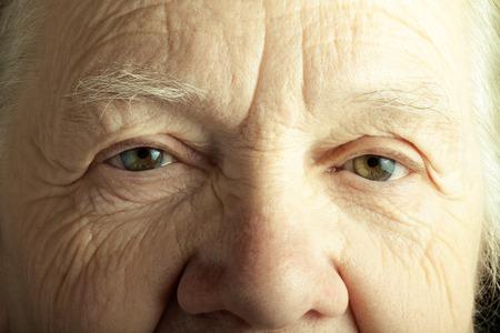 grayness: Portrait of elderly woman. Closeup view. Toned. Stock Photo