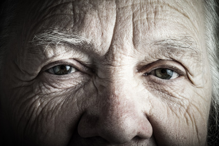 grayness: Portrait of elderly woman. Closeup view. Toned. Stock Photo