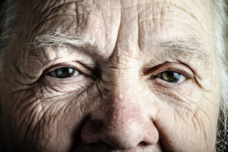 Portrait of elderly woman. Closeup view. Toned. Standard-Bild