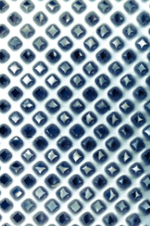 metal grater: The surface of metal grater for background. Toned.
