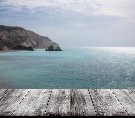 polis: Beautiful view of the Mediterranean Sea over old light wooden table or board. Collage. Selective Focus. Stock Photo