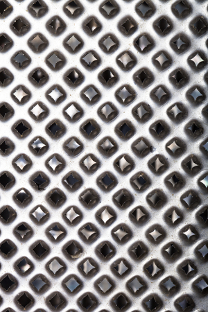 metal grater: The surface of metal grater for background. Stock Photo
